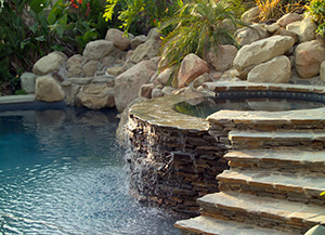 Landscape Pool Design With Water Fountain in Small Backyard