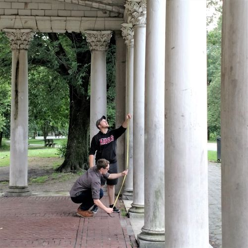 Benedictine College students Ian Reilly (standing, former Aquinas Learning student) and Jack Edwards study classical architecture on site in New York City.