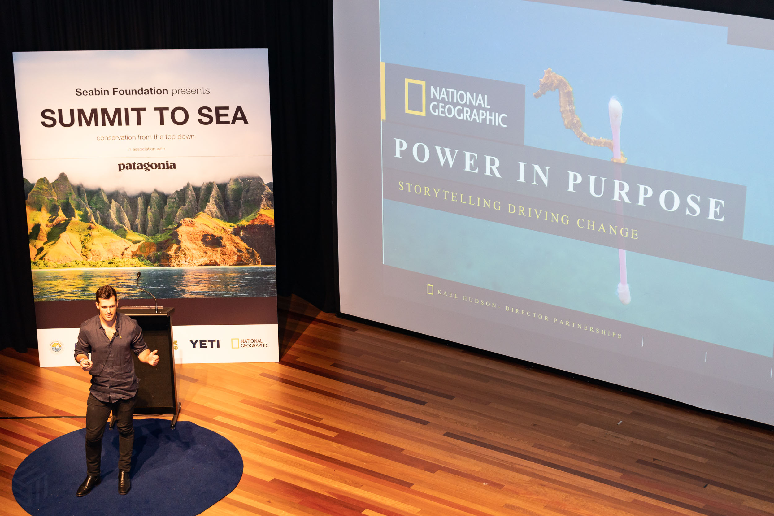 Kael Hudson, director of partnerships from National Geographic presenting at the summit.