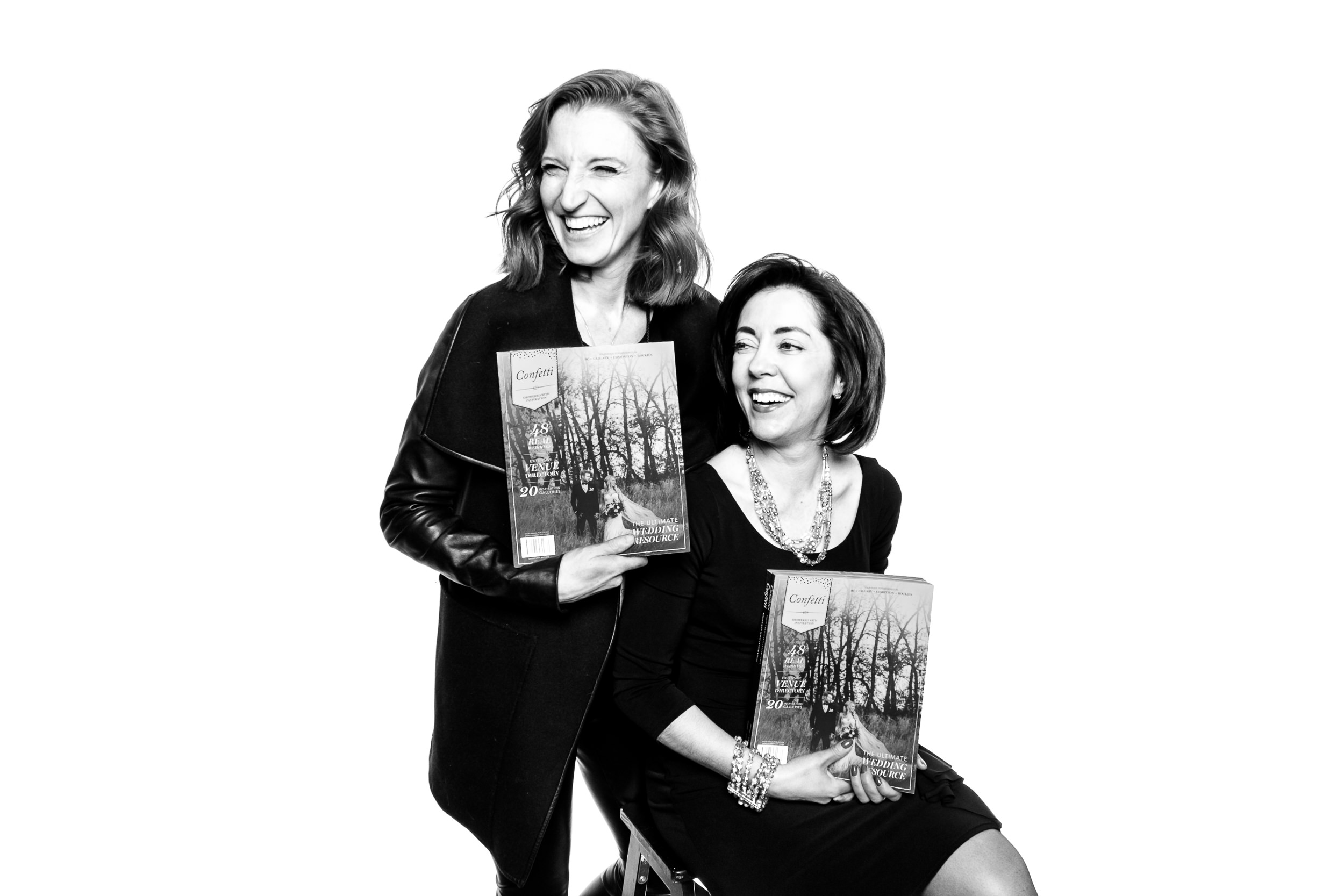 Alix and Fiona from Confetti Wedding Magazine rocking the black and white photo booth