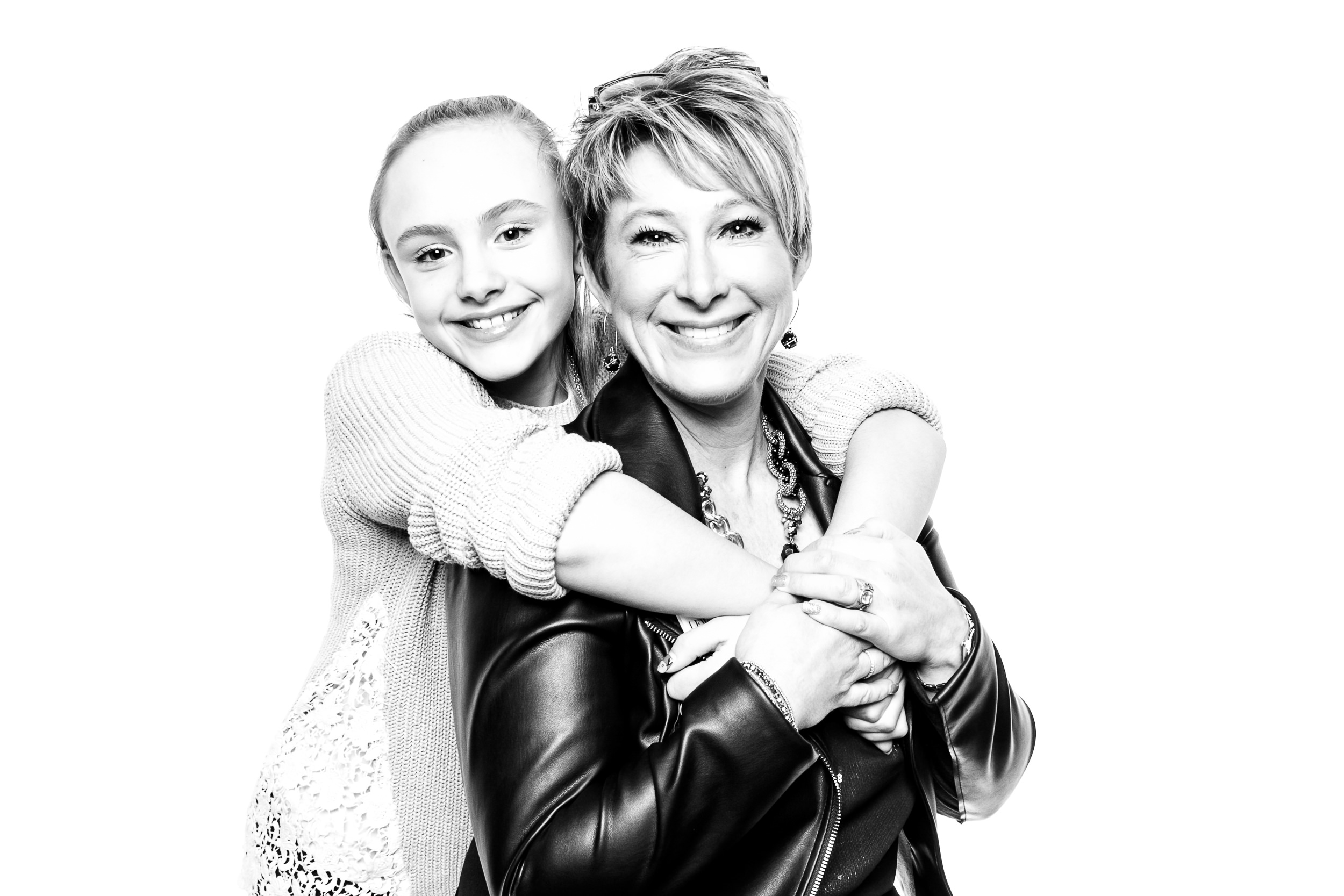 Lynn of Lynn Fletcher Weddings, posing for a portrait with her daughter in the black and white photo booth
