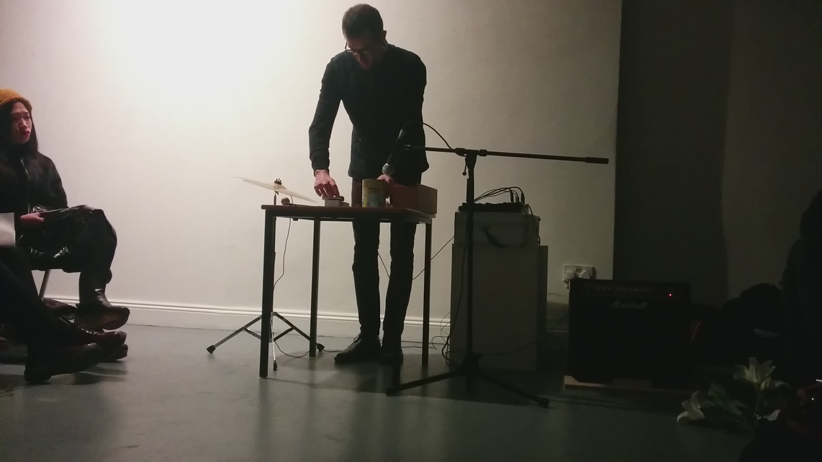 Performing  Approaching The Object  at Constantly Evolving But Never Ending, Angus-Hughes Gallery, London 2015 using cocoa tin, metal ruler amplified table top, glass jar, cymbal and various found and collected objects.