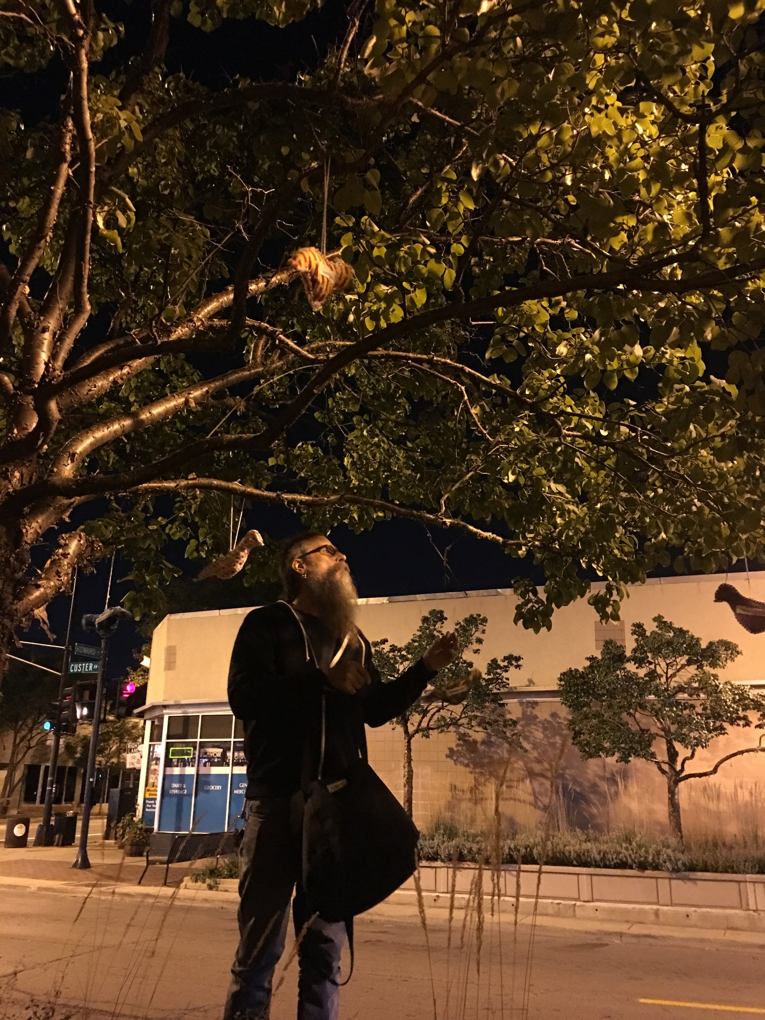 John-Michael hangs birds at the site of a recent shooting.