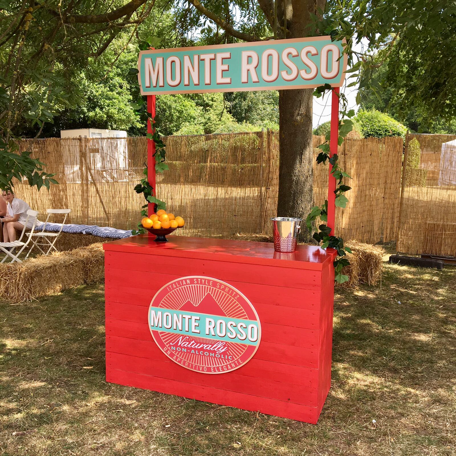 Monte Rosso Sampling Station Red wooden bar at House Festival.jpg