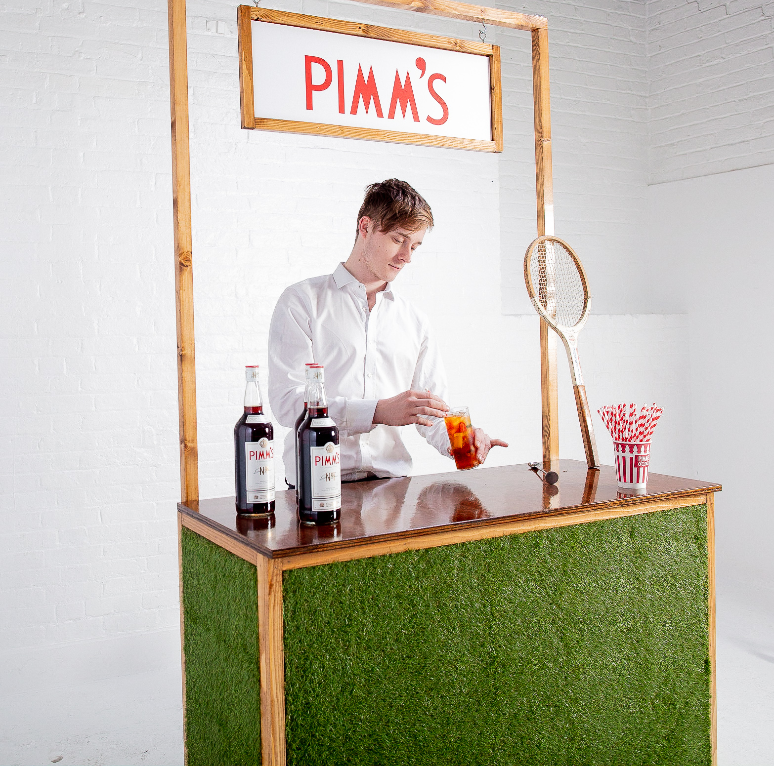 Quirky Group grass bar for hire with brand ambassador bartender serving Pimm's cocktails