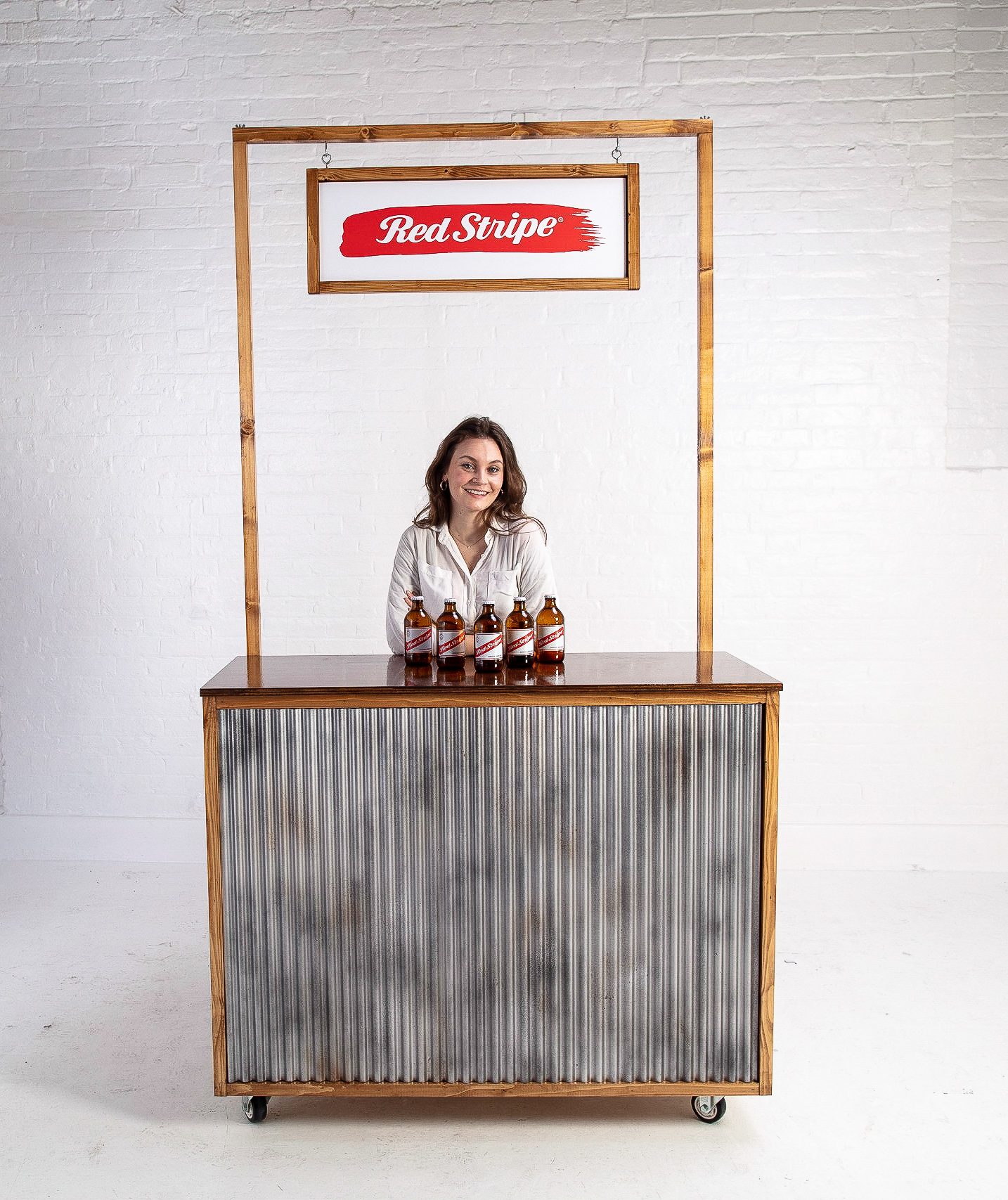 Quirky Group Industrial corrugated iron bar for hire with Brand Ambassador serving drinks