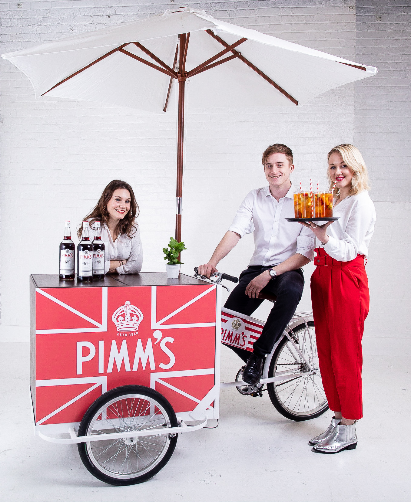 Quirky Group Pimms Tricycle Bar with brand ambassadors serving cocktails