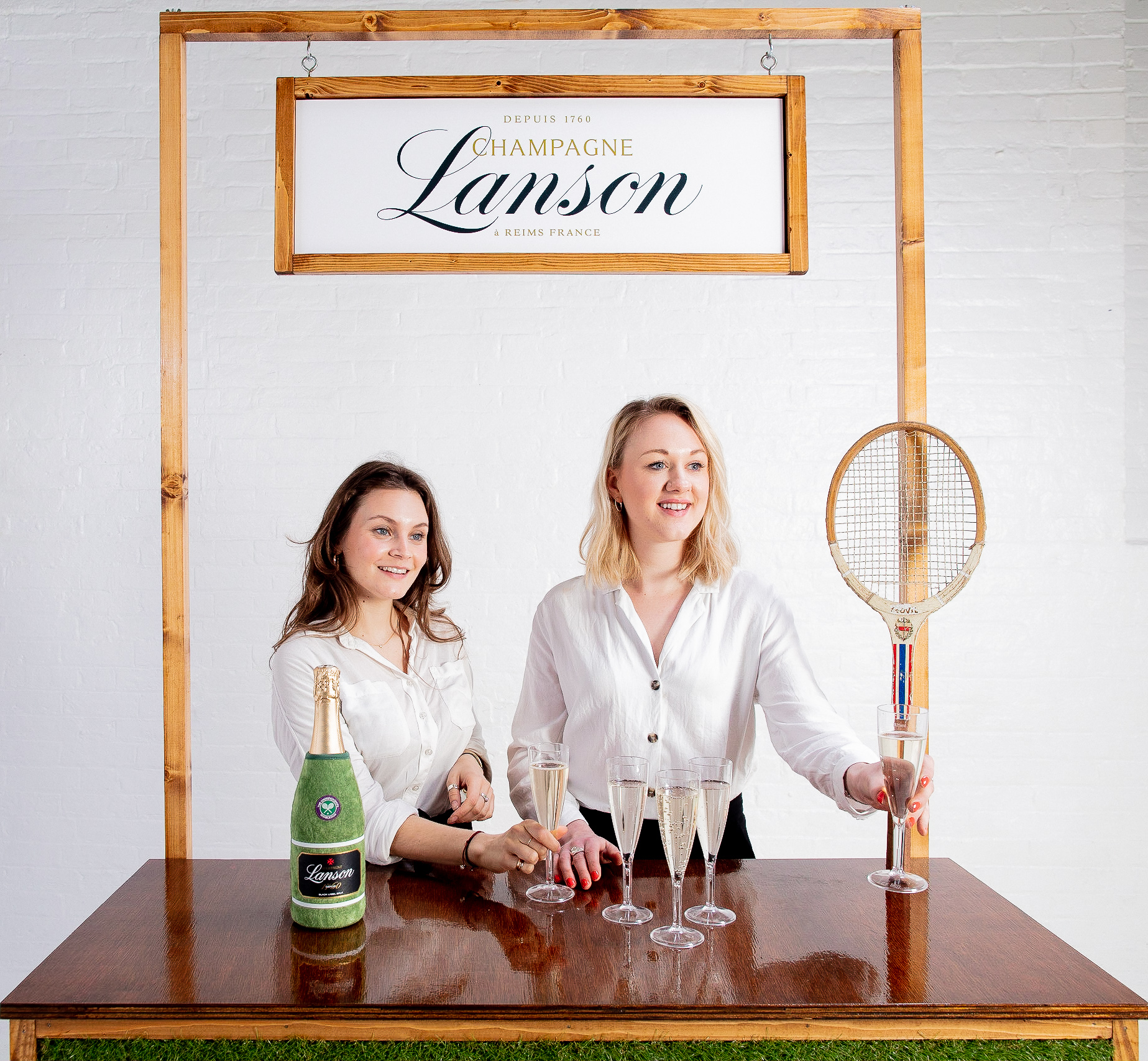 Quirky Group Brand Ambassadors serving champagne at Grass Bar