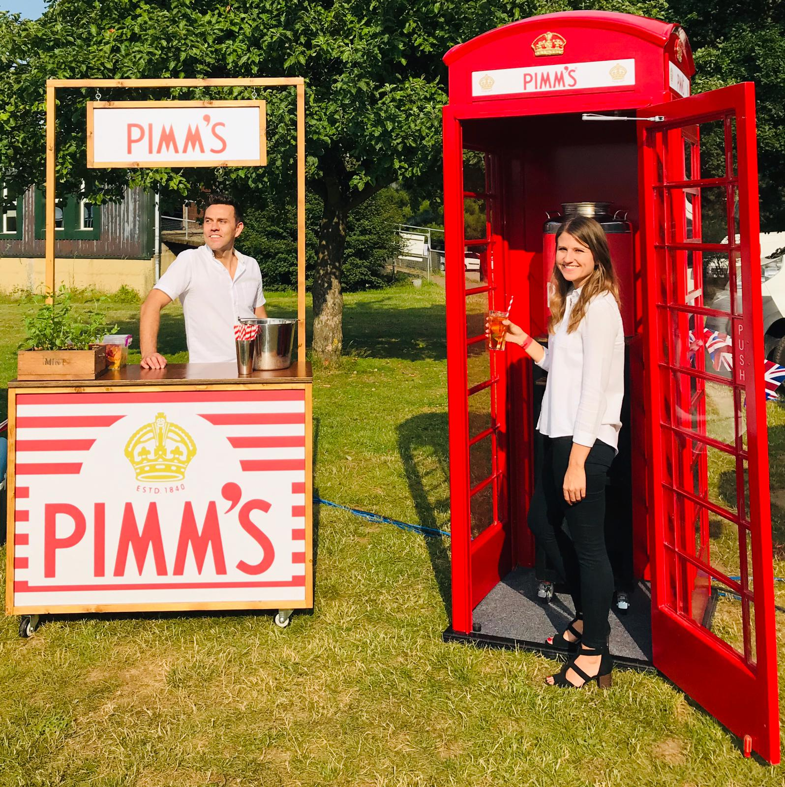 Quirky Group Phone Box bar hire at a festival event