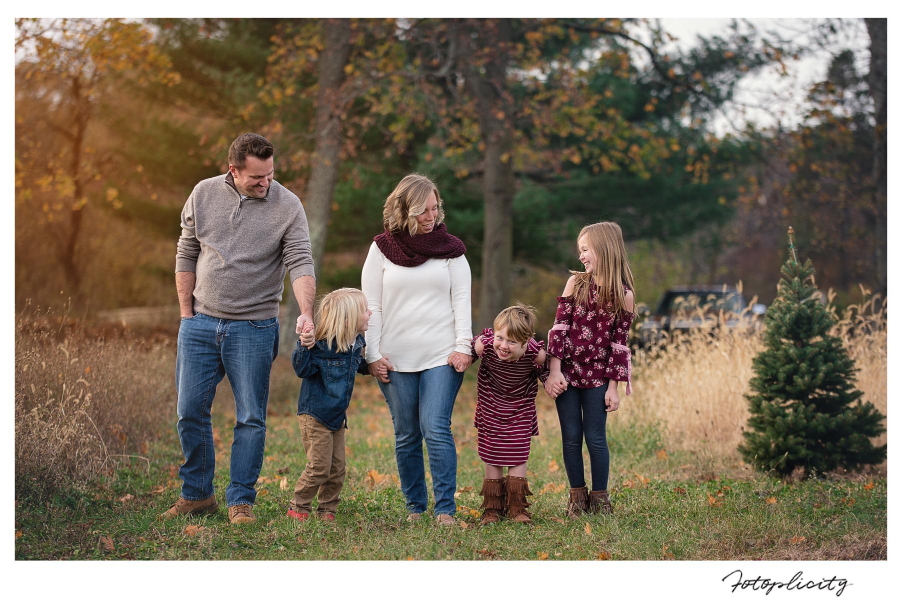 Family walking in field by Fotoplicity
