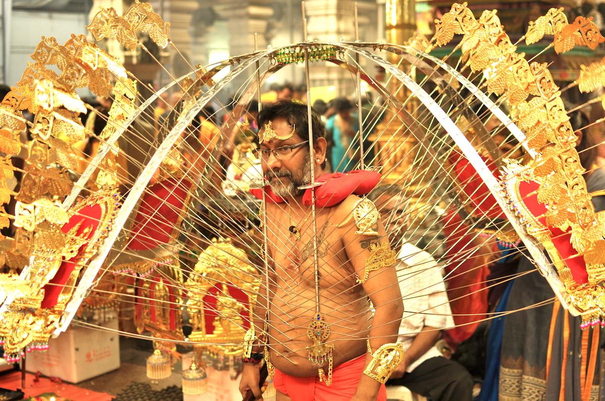 A devotee bearing a Kavadi at Sri Srinivasa Perumal (Singapore). Photo: David Mattatia