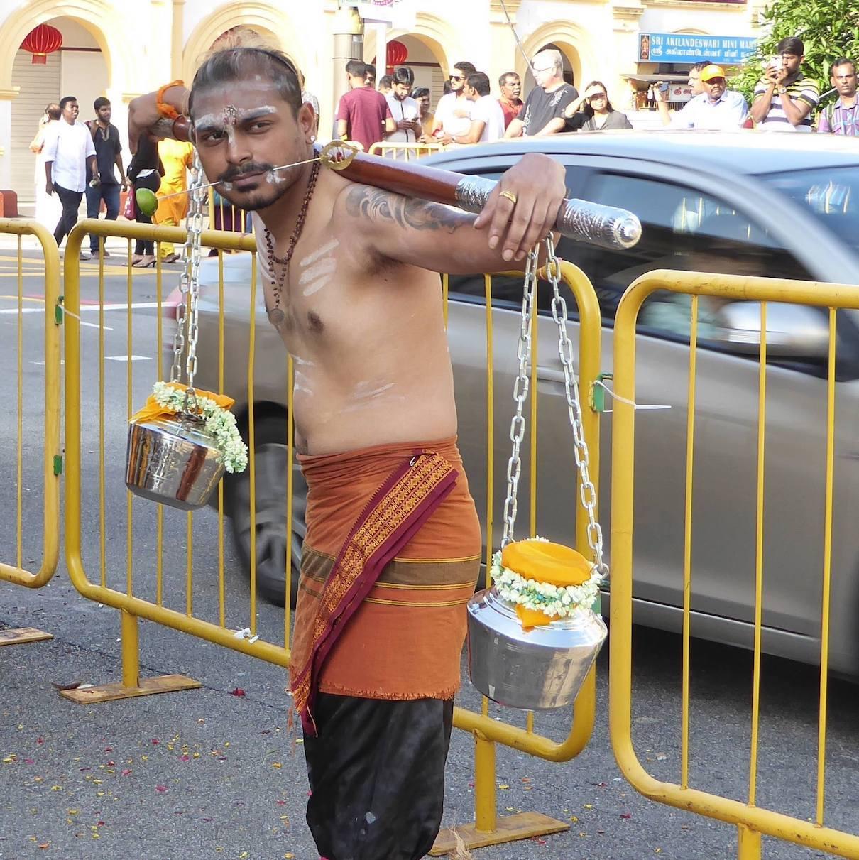 Devotee bearing kavadi and milk pots at Thaipusam. Photo: Fernanda Brocoletti