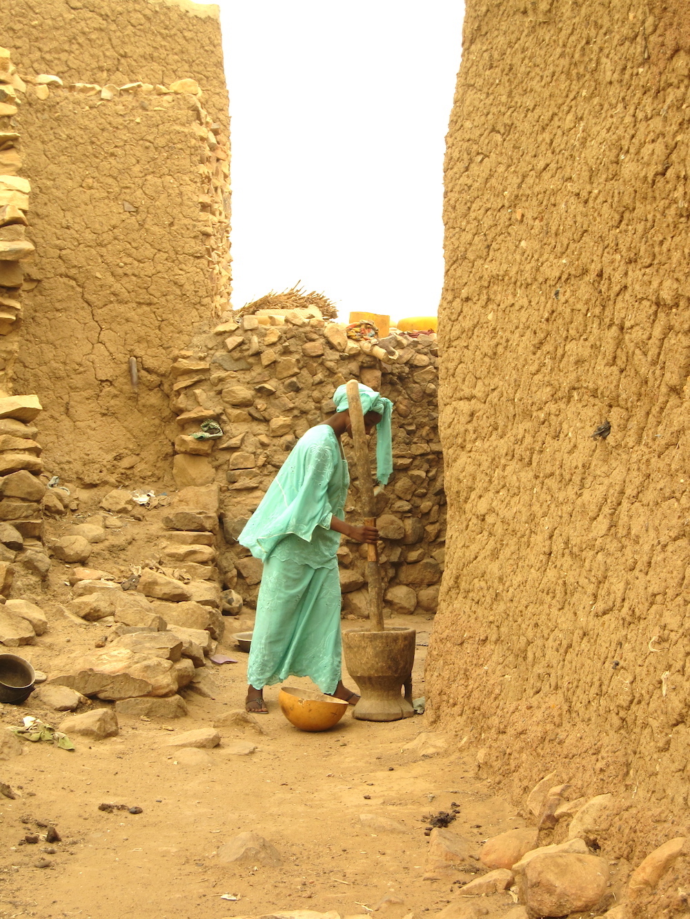 A woman prepares artisanal beer in a street of Hombori, Mali. Photo: Patti Neves