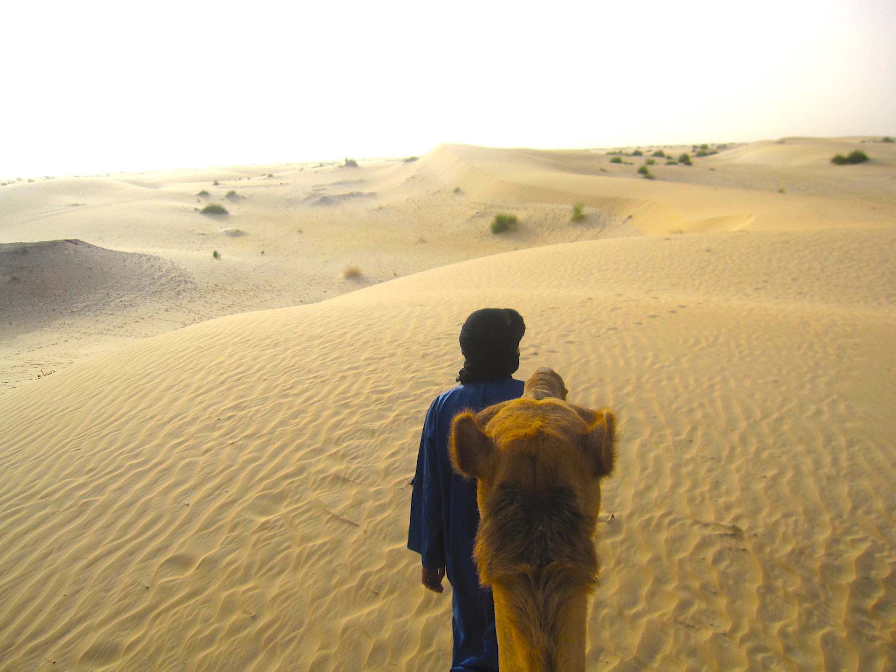 My Tuareg guide and I, heading to the camp site in the Sahara. Photo: Patti Neves