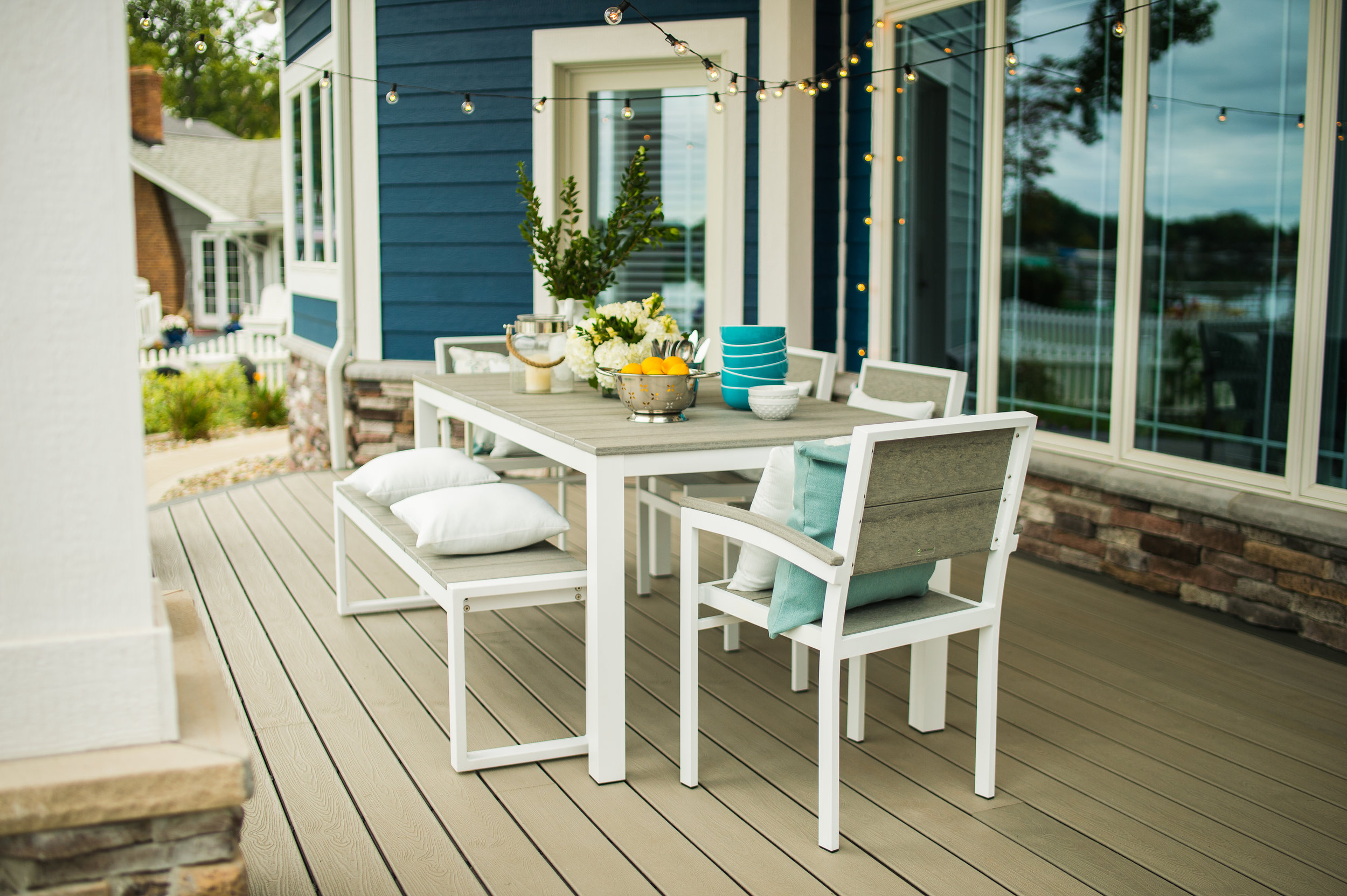 Park City - Bring the family together for outdoor picnics, summer chats, and board games under the stars with the Park City Modern Outdoor Dining Collection. This modern outdoor dining collection is made with a durable, open-style powder-coated aluminum frame, which is available in three beautiful color options. Choose between textured black, gloss silver, and textured white for an outdoor dining set that perfectly matches your landscaping and decor. The cozy outdoor dining side chairs,arm chairs, and benches along with the sleek tabletop are made with premium HDPE slats and accentuated with a gorgeous, natural wood grain. This set delivers the authentic wood look that you want with the all-weather durability that you need for years of happy outdoor memories to come. You'll love this collection for its simplicity and custom options.