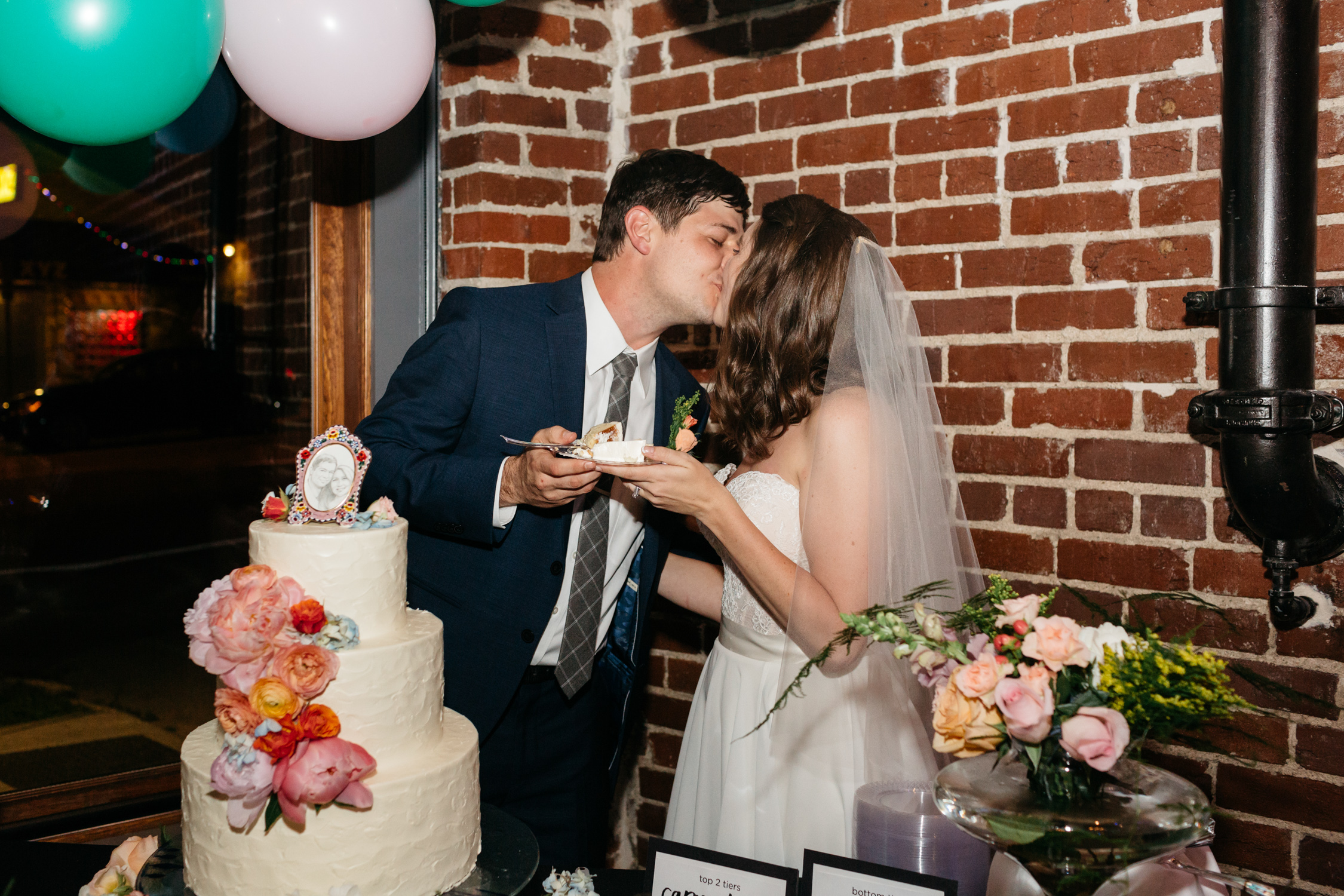 Standard Downtown Knoxville Wedding Venue Central Avenue Happy Holler Cut the cake Exposed Brick