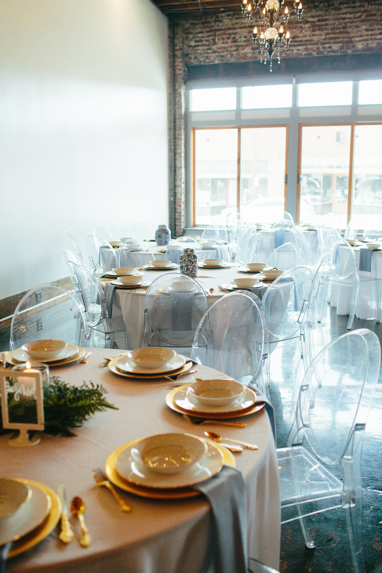 Downtown Knoxville Wedding Reception Venue // Botanical Wedding // Gold Chargers & Lucite Chairs