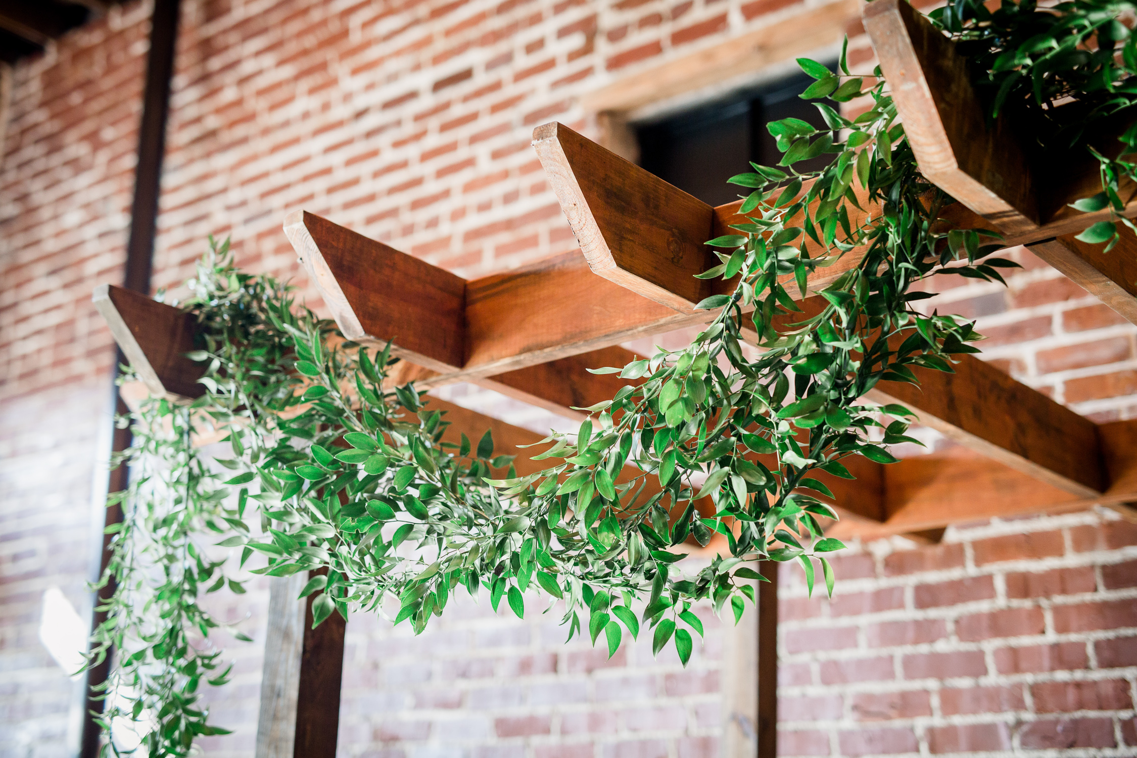 Downtown Knoxville Wedding Venue // Central Avenue Reception // Bridesmaids // Relix Knoxville Floral Design Greenery Arbor