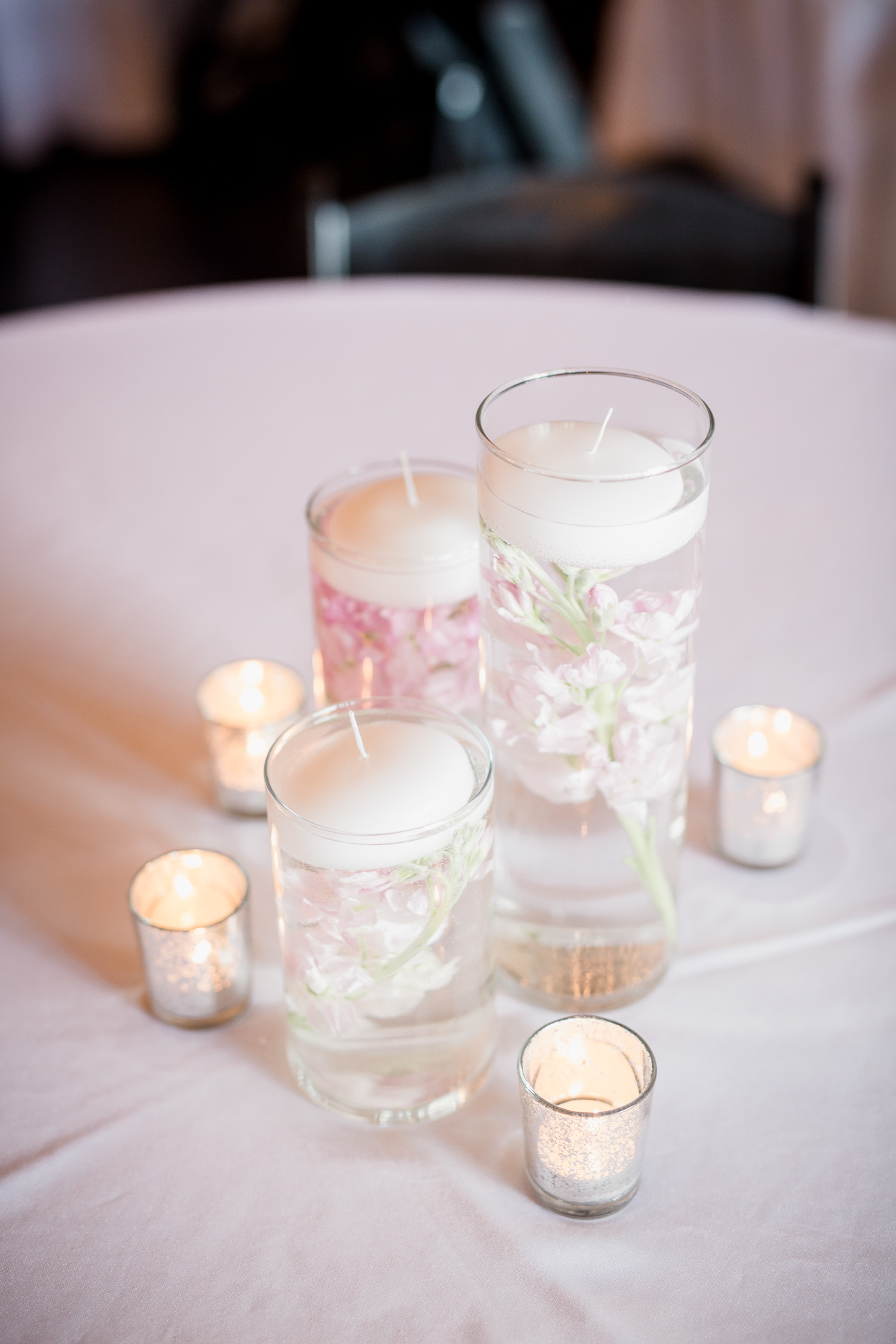 Downtown Knoxville Wedding Venue // Central Avenue Reception // Bridesmaids // Relix Knoxville Floral Design Floating Candles and Orchids