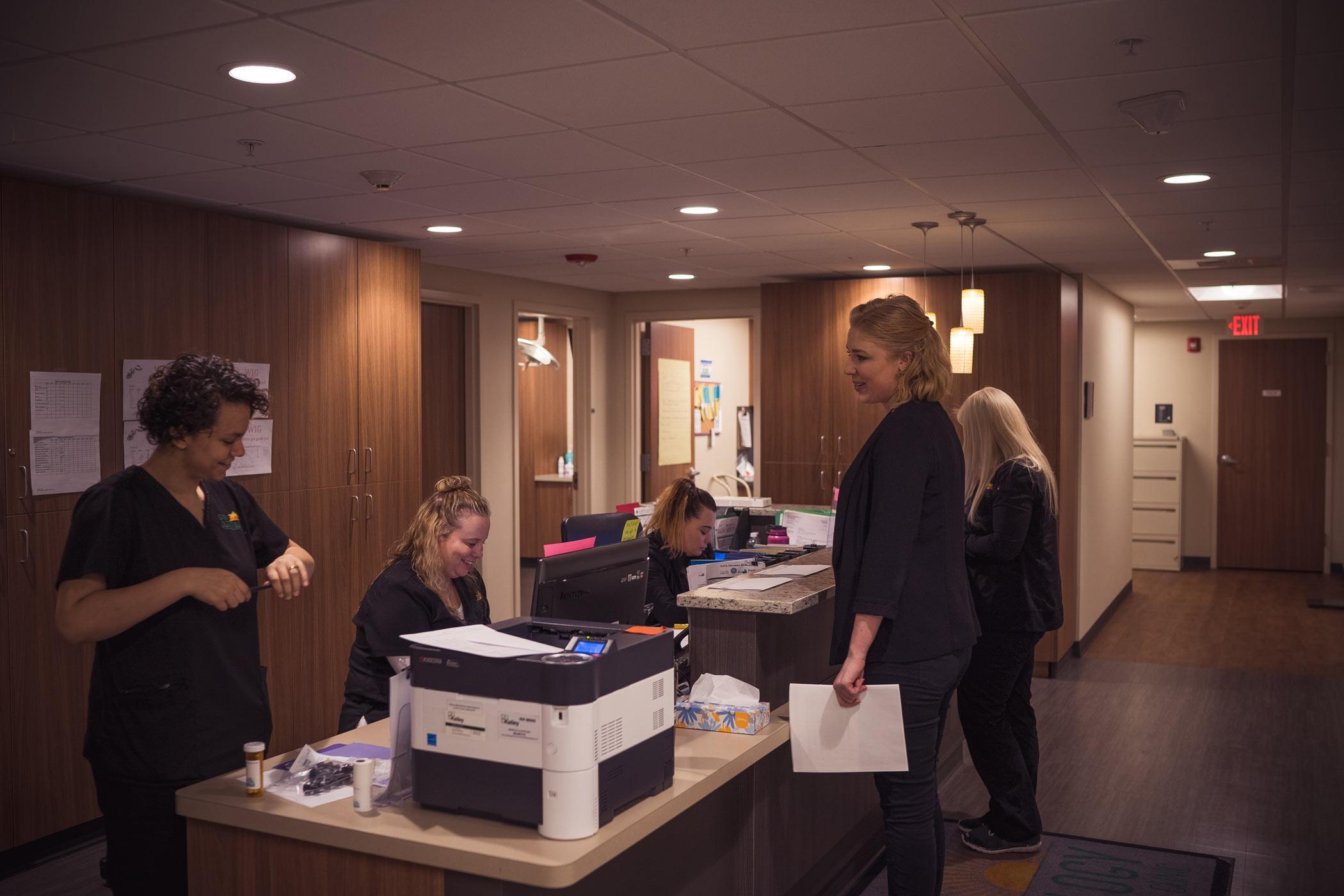 spokane-dermatology-employees-reviewing-files.jpg