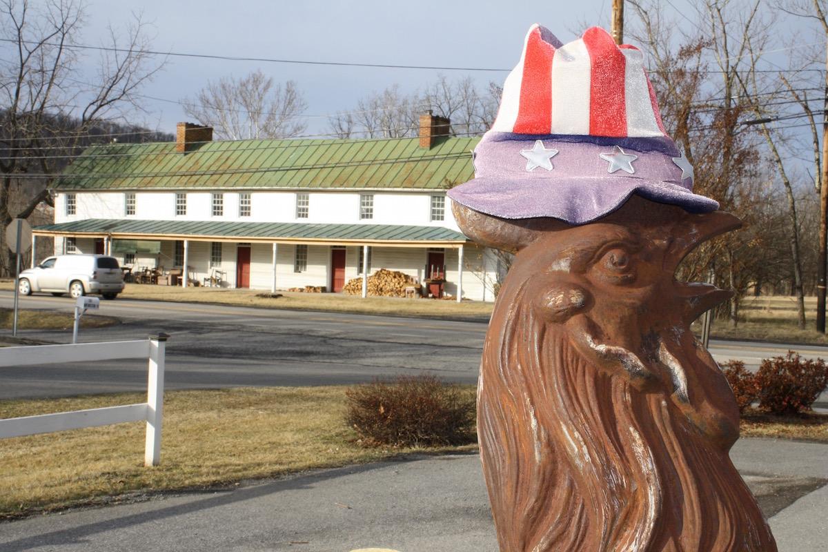 w Greg's Chicken mascot with Frye's Tavern behind .jpeg