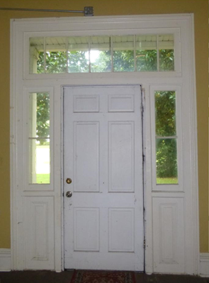 Interior view of front door and surround (door is not original)