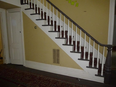 Foyer staircase (Note small closet beneath stairs)