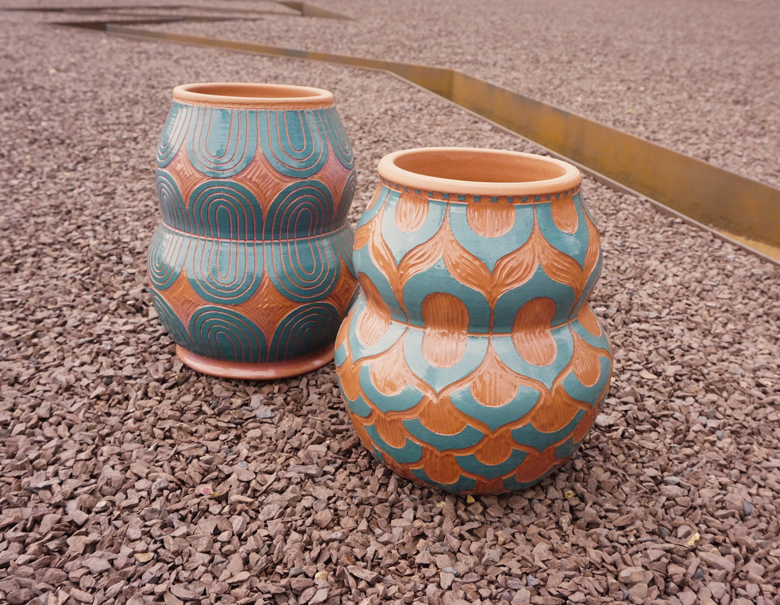 GABO MARTINEZ . FRONT:  Maceta de Petalos , 2019. Terracotta, slip, sgraffito. 9.5 x 7 x 7 inches. BACK:  Footed Petaled Planter,  2019. Terracotta, slip, sgraffito. 10.5 x 7 x 7 inches.