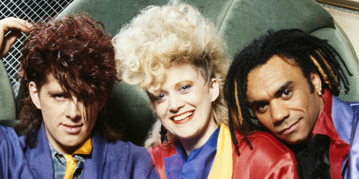 Note: This isn't us either. This is the Thompson Twins, the wonderful New Wave act in the 80's. More on them in a minute…