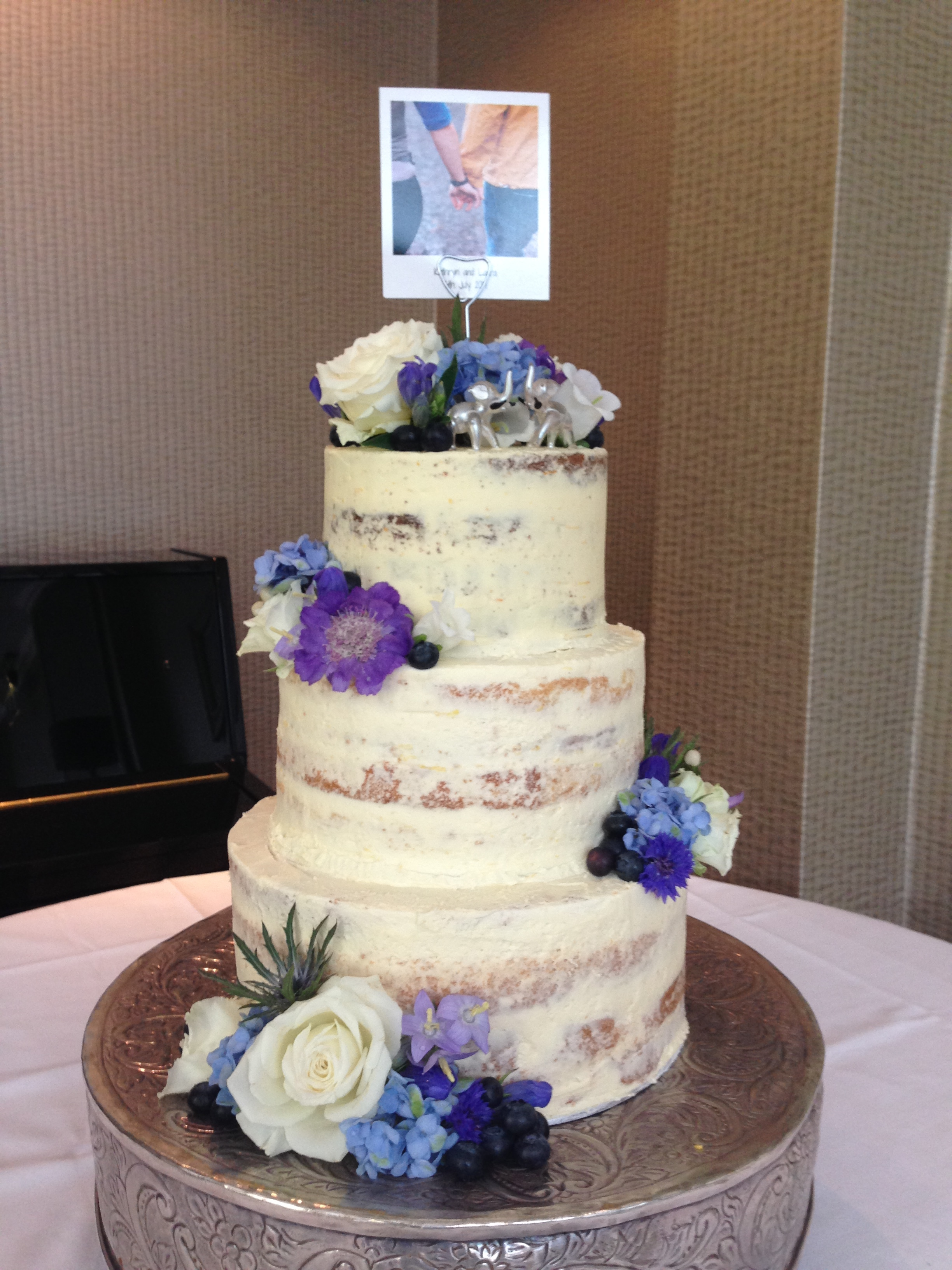 semi naked wedding cake. Loren Brand Cakes. Purple and blue cake