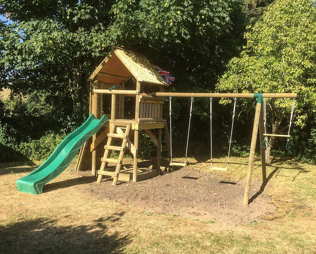 """Coaley Playtower & Swings - """"From concept to installation, Rich has been superb. happy to discuss options and come up with creative designs within a budget! The craftsmanship of the finished climbing frame surpassed my expectations - it's solidly built and beautifully finished. My children love it!!! I can't recommend Rich highly enough!! thank you!""""Mrs Johnson - Coaley"""