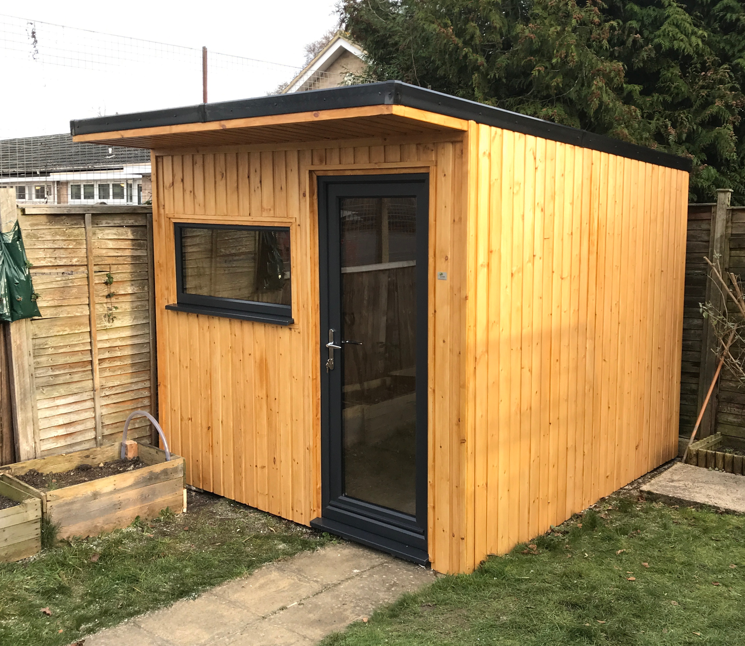 """Cheltenham Garden Office - """"From start to finish Rich was there to give me help with the space I needed to be able to work more freely at home.His designs in the space were spot on and was perfect for what I thought i wanted.The craftsmanship is second to none, every detail taken care of and my home office is stunning to look at. It hardly took any time at all to build. No mess , no fuss at all.It's lovely and warm, cant hear noise outside and it even has its own doorbell.Would thoroughly recommended R Design to anyone who needs that extra bit of space. Thanks so much Rich, it is just perfect!""""Mrs Summersby - Cheltenham"""
