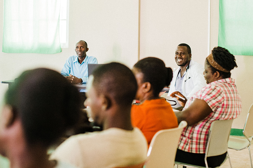 A Community Health Program meeting. The program has grown to include 1,030 families in one year.