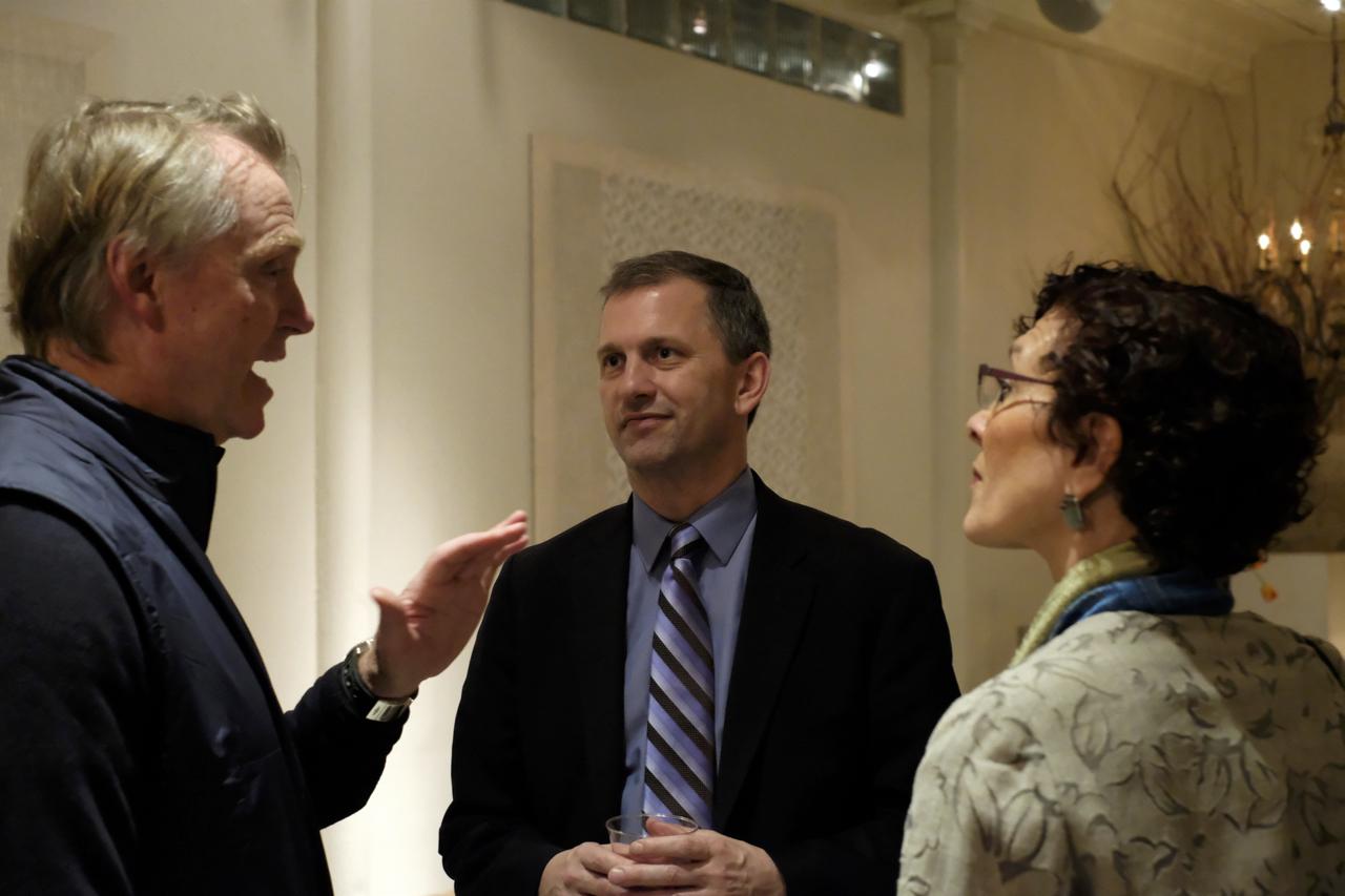 Sean Casten (center).
