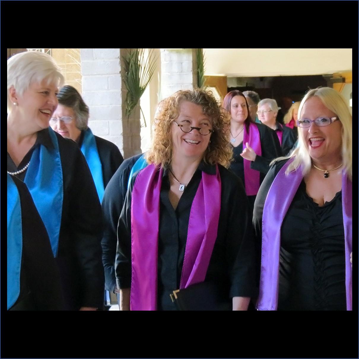 Phoenix Women Chorus Singers heading to the stage.
