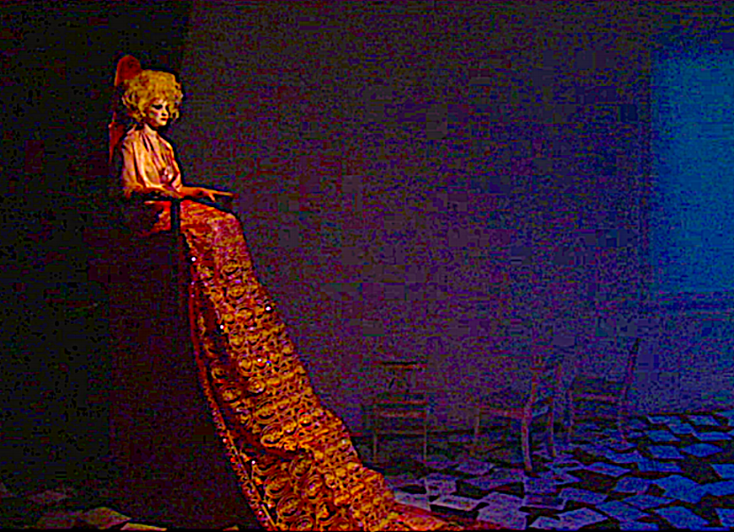 """...ON THE OTHER SIDE OF THE STAGE WAS A KIND OF GOTHIC THRONE ON WHICH ANOTHER WOMAN (BETSY MOORE) SAT LOOMING AND GLARING FROM AN ALTITUDE CLOSE TO THE RAFTERS.  (PRODUCTION DESIGN BY J GOODKIND).  A BAROQUE GOWN DRAPED BELOW  HER SOME 10 TO 15 FEET . . . ""      LA WEEKLY"
