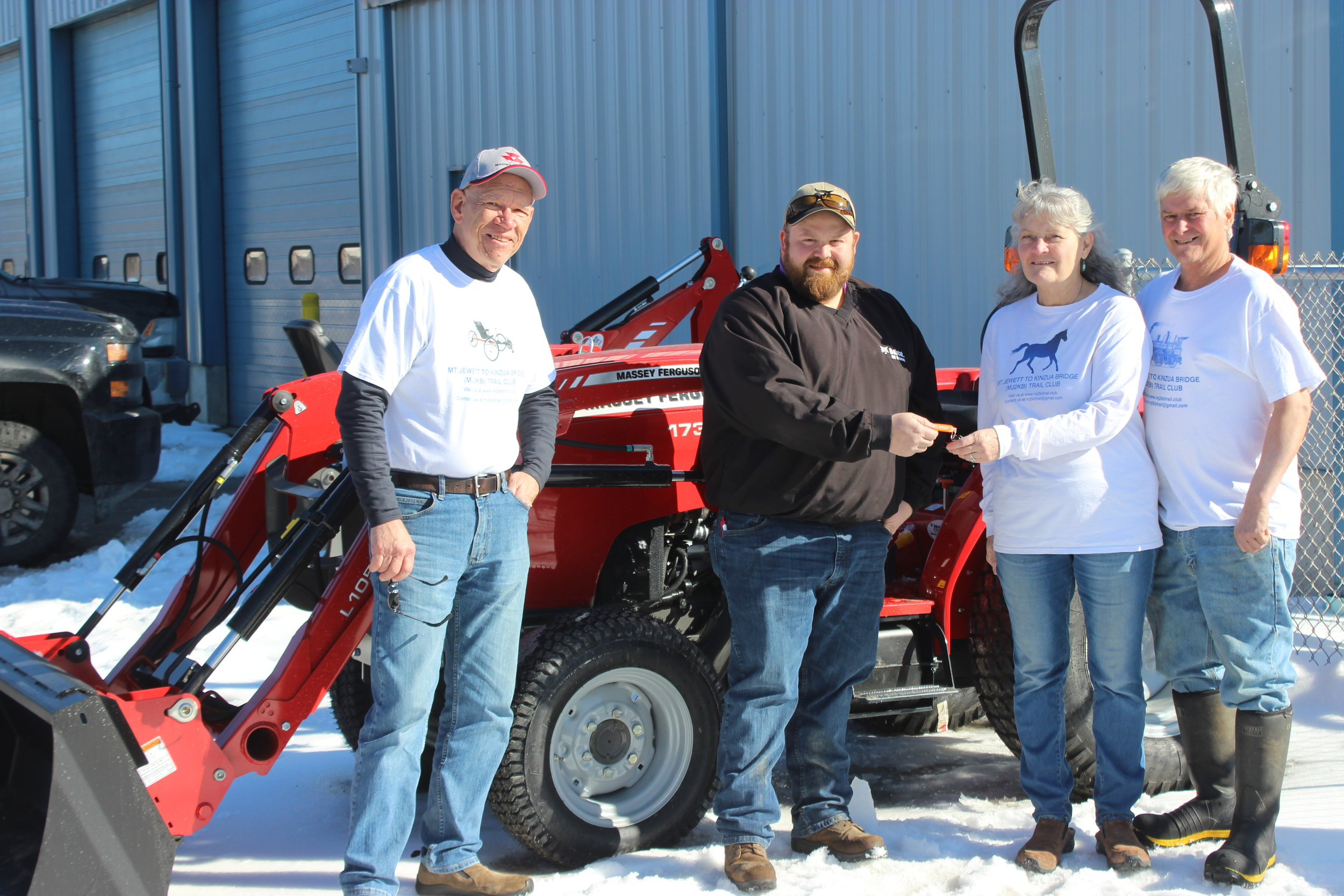 Getting the keys to our new tractor purchased through a grant from the Pittsburgh Foundation Trail Fund. From left to right: Jack Forquer, Derek Carlson (Bobcat of Kane), Carolyn & Ken Stroup. Photo-Ted Lutz (Kane Republican)
