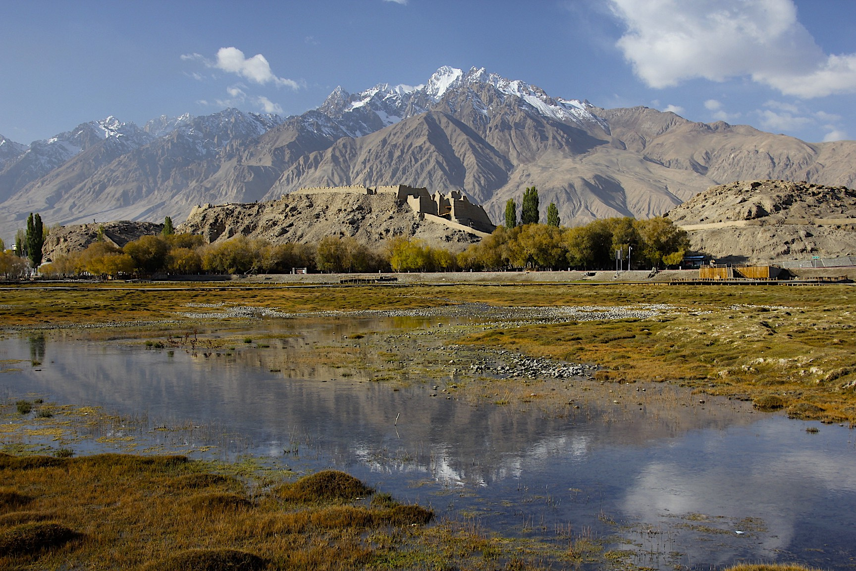 Tashkurgan old fort and the Pamir Mountains near the border of China, Pakistan and Afghanistan