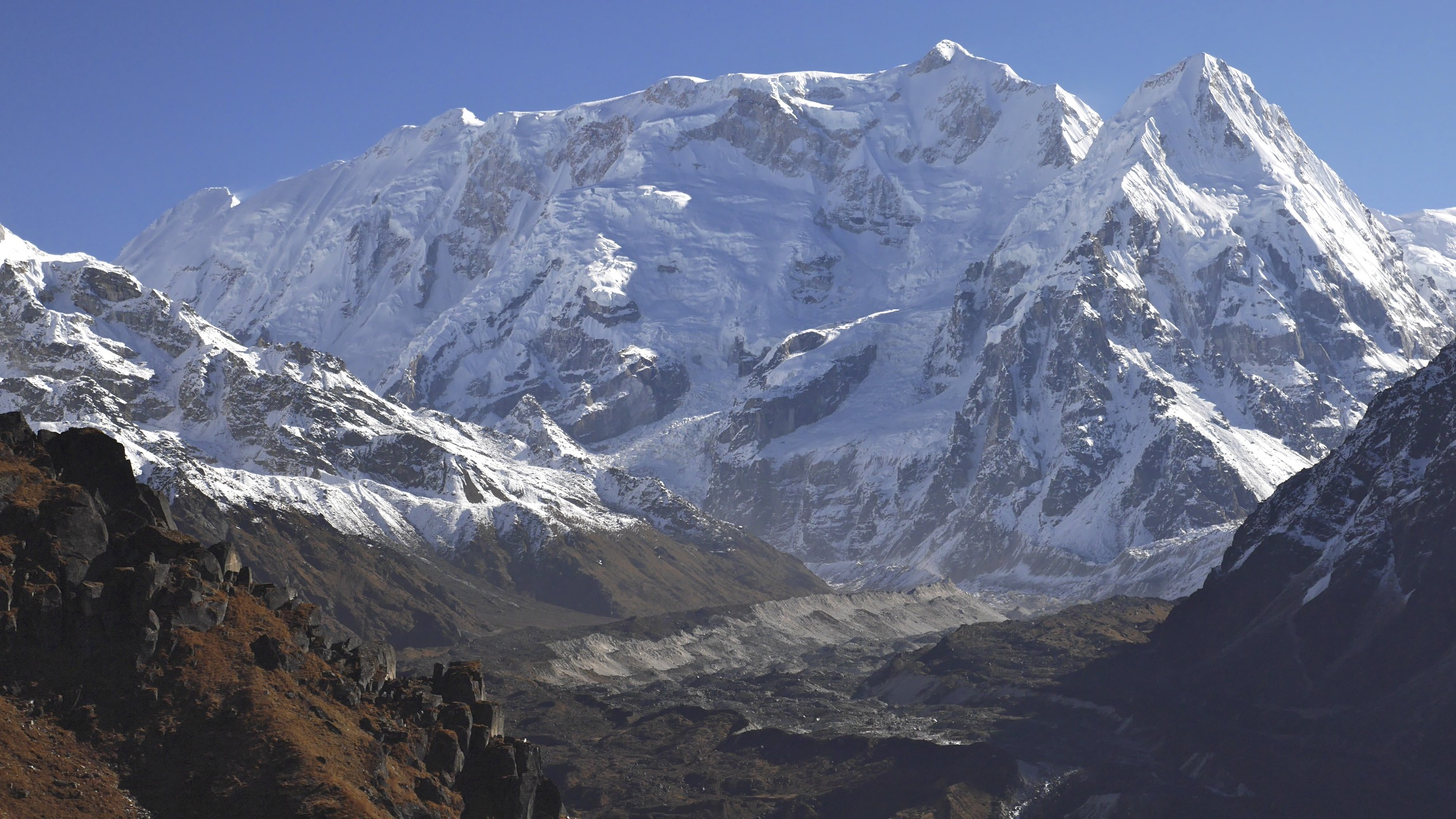 The view from the Sinjon La Pass connecting the south and north side of the Kangchendzonga trek. The long ridge is Kabru North (left) 7,338m and Kabru South 7,311m. The peak on the right is Ratong 6,679m.