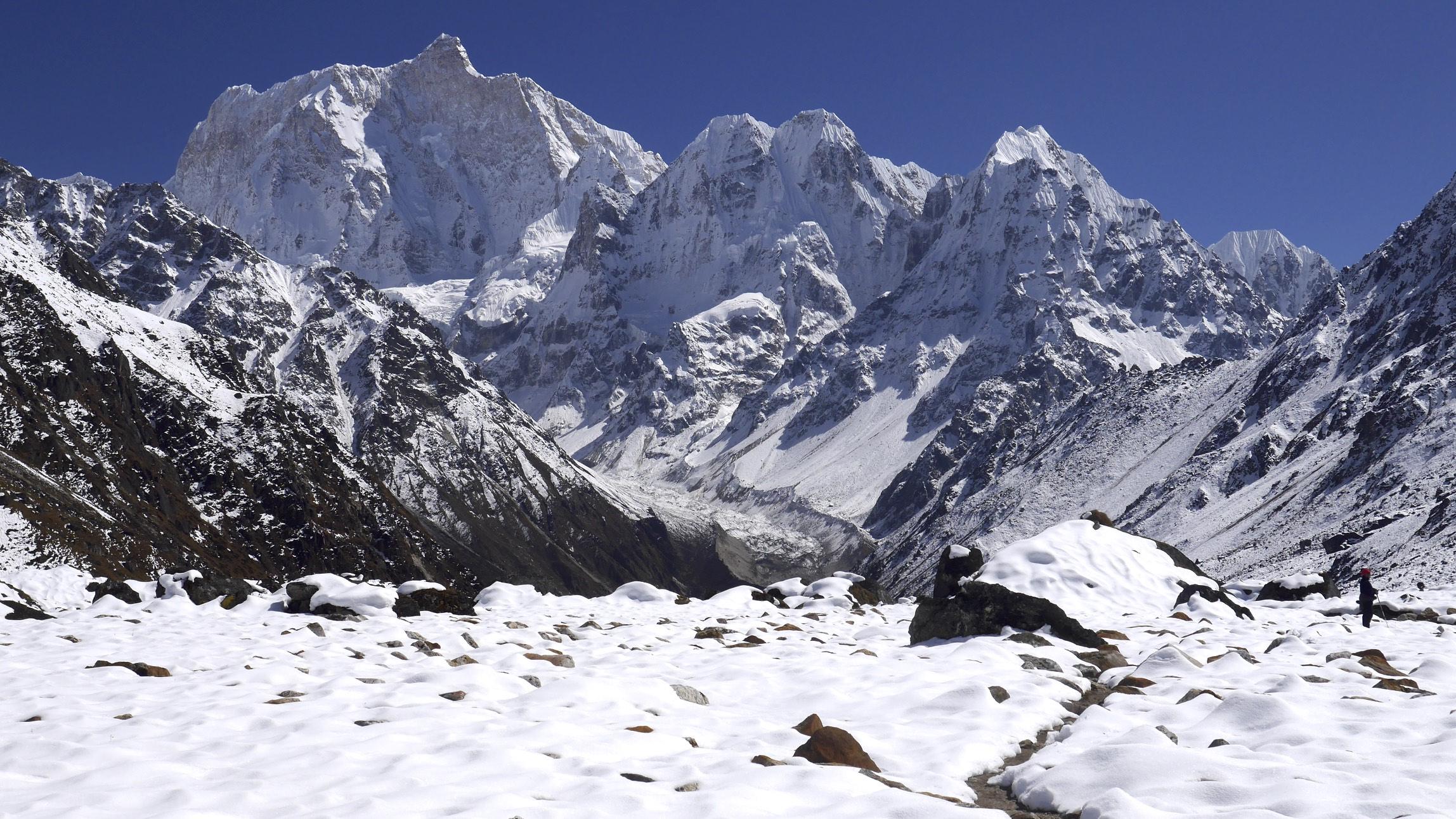 Janu Peak 7,710m, Sobi Thongje 6,670m, Pholesobi Thonje 6,645m and Temachungi 6,044m with the Kumbhakarma Glacier below - hiking above the Nupchu Valley and exploring the area.