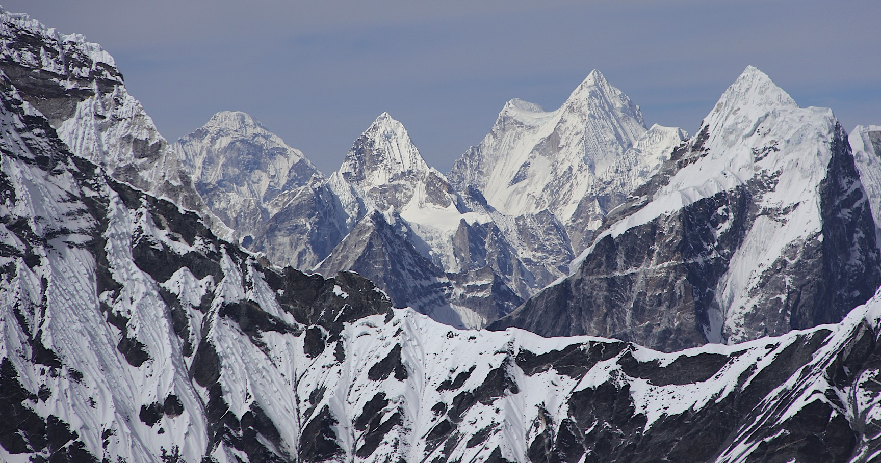 Mt. Menlungtse (looks like a saddle) in Tibet from the West Col.