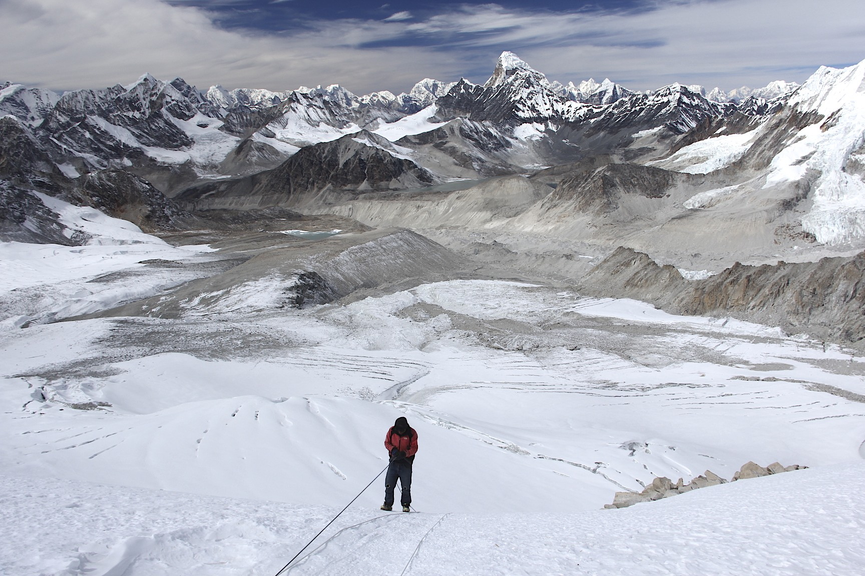 Looking down from the West Col Pass at 6,150m. Descending from the West Col with a spectacular panorama of high Himalaya. You can even see Shishapagma on the extreme right in the far distance.