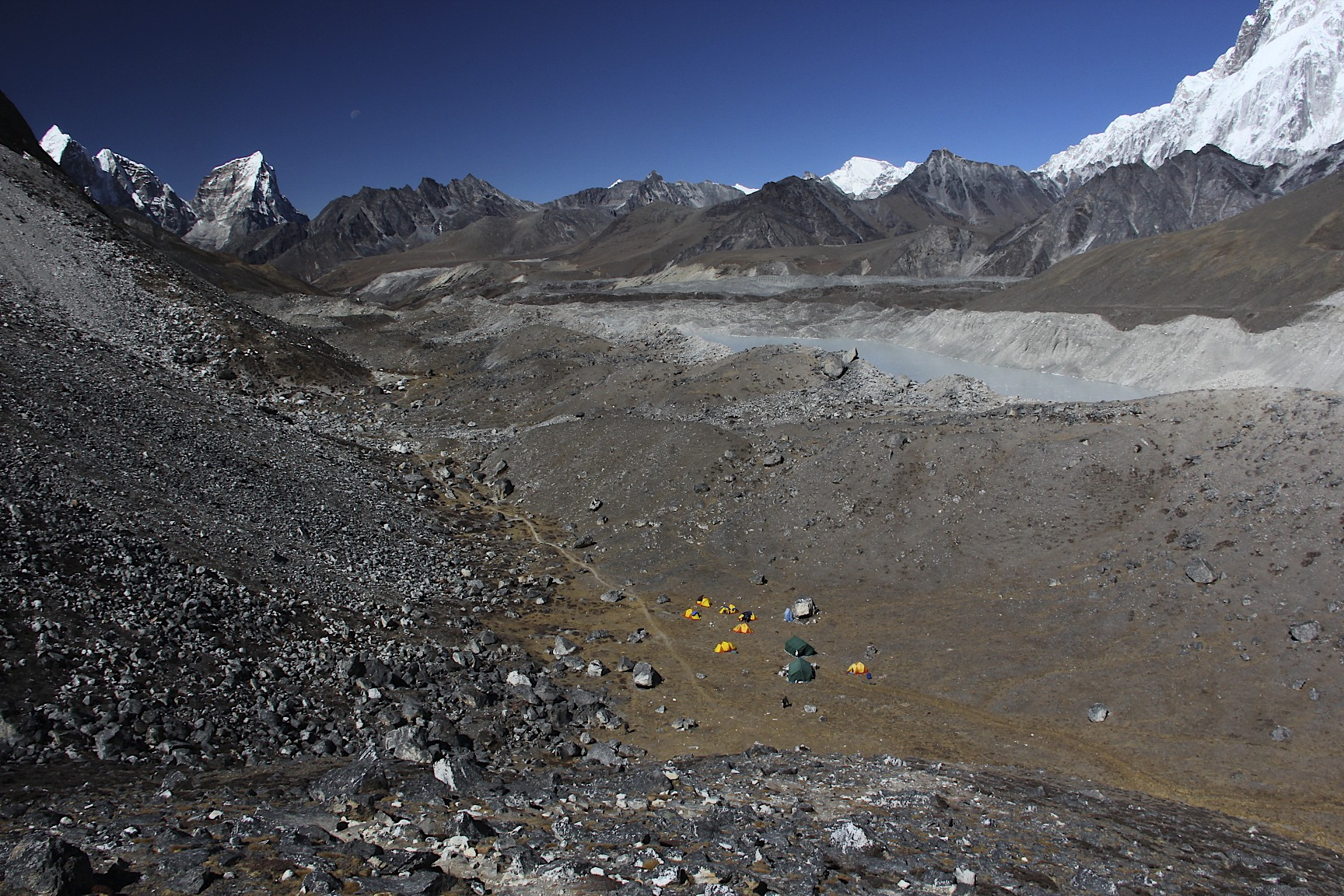 Mt. Cholatese, Mt. Cho Oyu (in the distance right of centre) and Lhotse massif on the right.