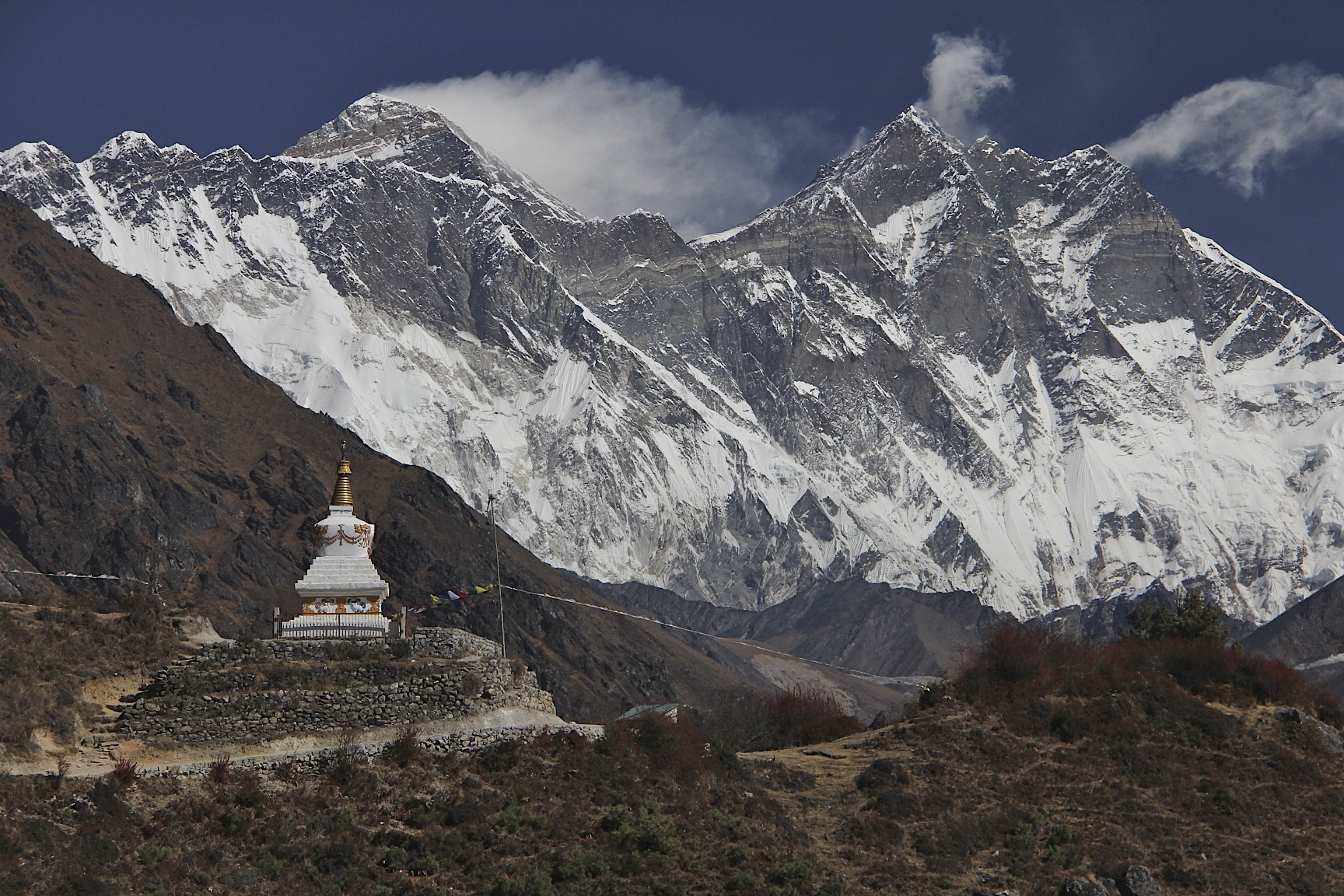 Nuptse, Mount Everest (behind the ridge) and Lhotse (on the right). Notice the strong wind blowing across Mt,. Everest's summit.