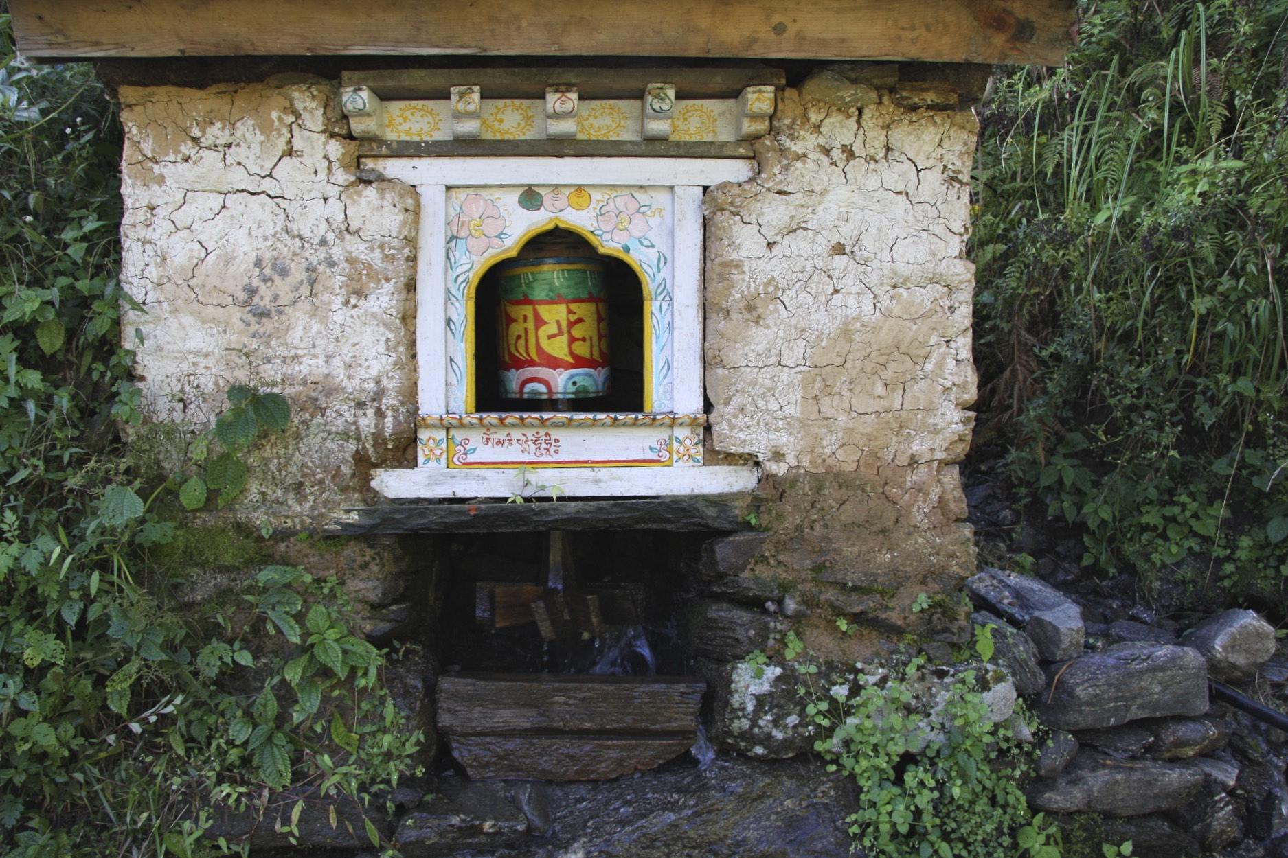 Water powered prayer wheel.