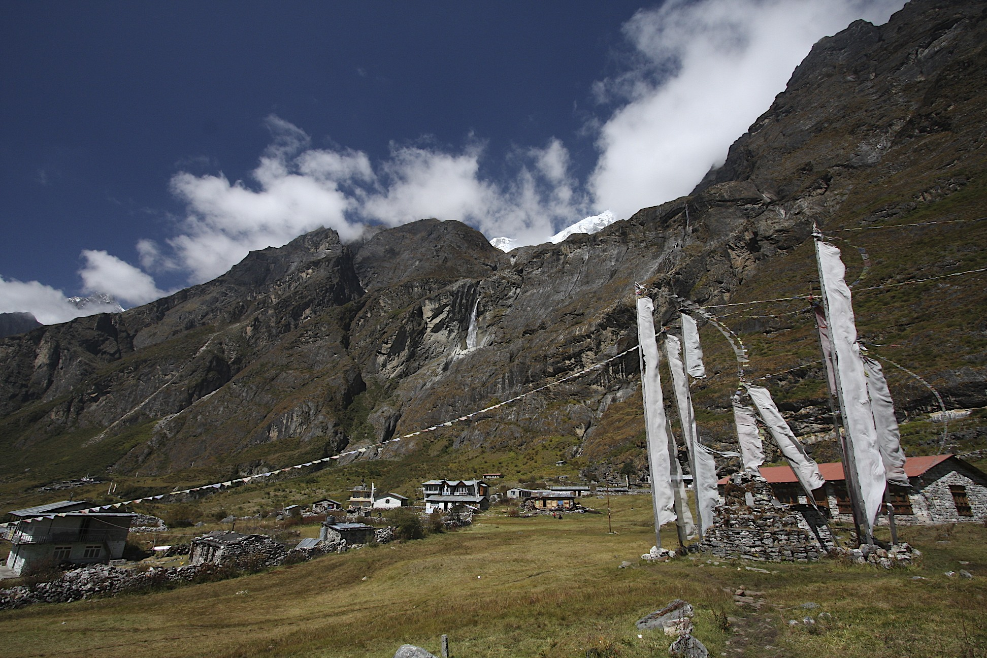 Langtang Village buried by the earthquake of 2014 by the avalanche from the glacier visible above the rocky cliffs.