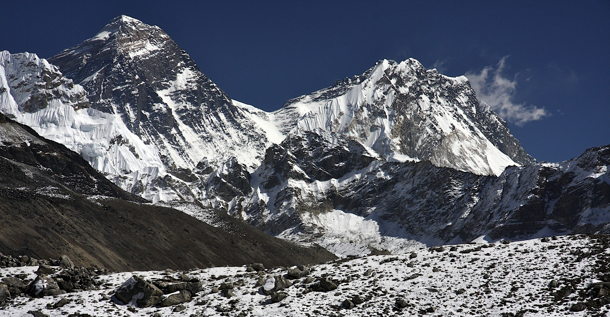 Everest and Lhotse from upper Ngozumpa Glacier.  On the left is the Changri Pass.