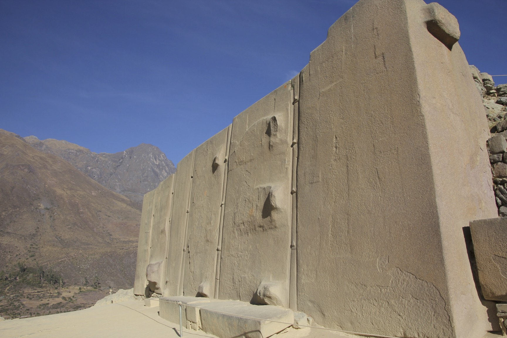 The Ollantaytambo Fortress. the Wall of the Six Monoliths, a towering section of wall.