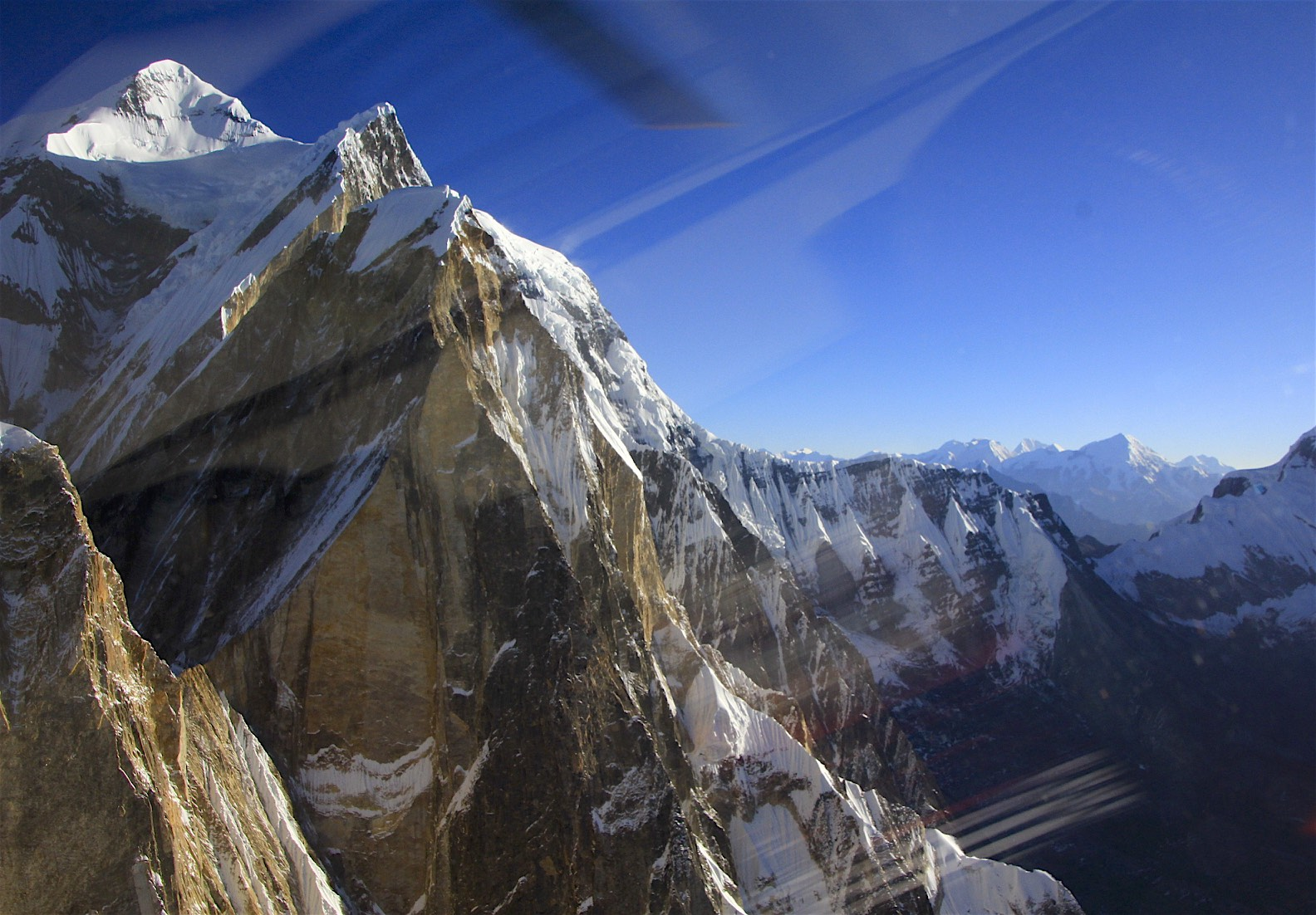 Annapurna III - the mountains on the horizon are on the border of Nepal and Tibet (China). Apparently the ridge visible in the photo on Annapurna III has not been climbed.