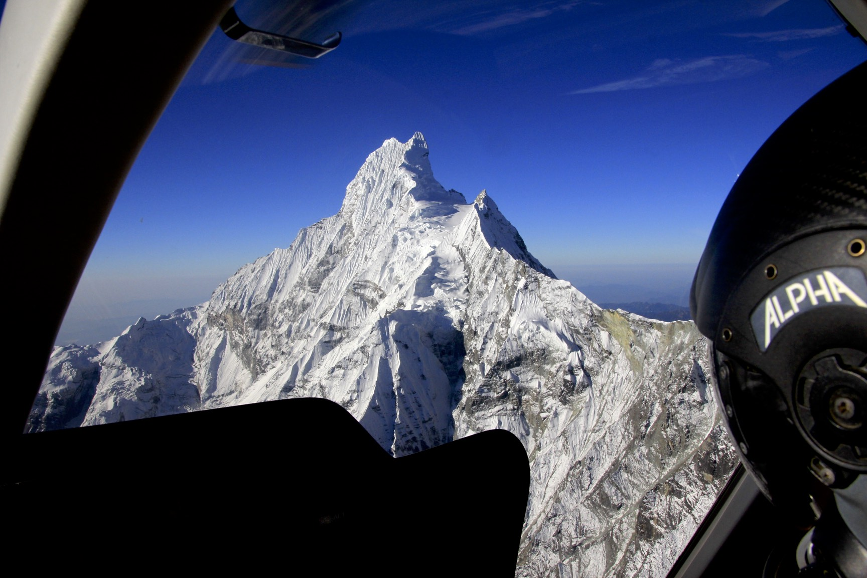 The north face of Machapuchare - absolutely spectacular from the helicopter at the altitude of almost 6,000m. This mountain looks awesome from all sides.